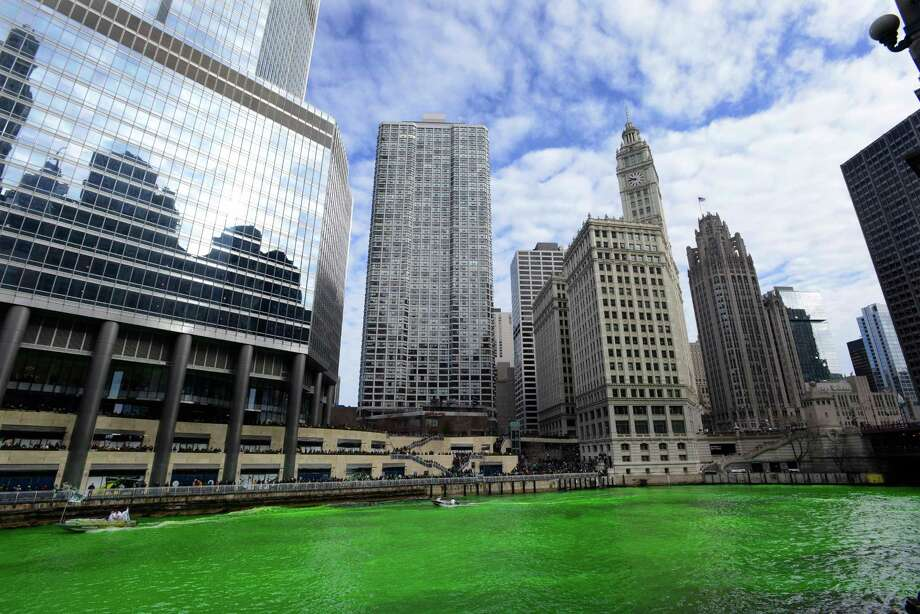 Dye colors the Chicago River green ahead of the St. Patrick's Day parade in Chicago on Saturday, March 15, 2014. The annual dying has been done since 1962. Photo: Paul Beaty, AP / FR36811 AP