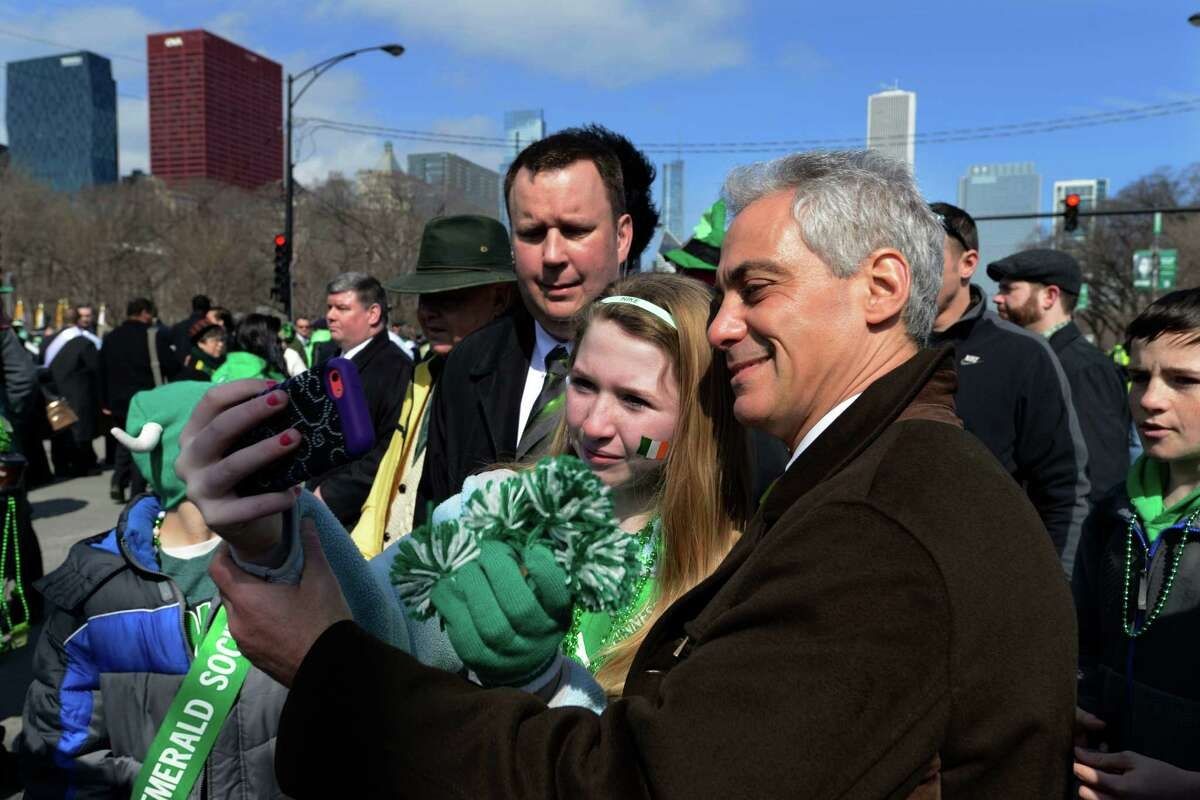 Chicago Mayor Rahm Emanuel poses for a photo with Grace Sullivan 11, of Lake Villa, Ill. before the St. Patrick's Day parade in Chicago, Saturday, March 15, 2014.