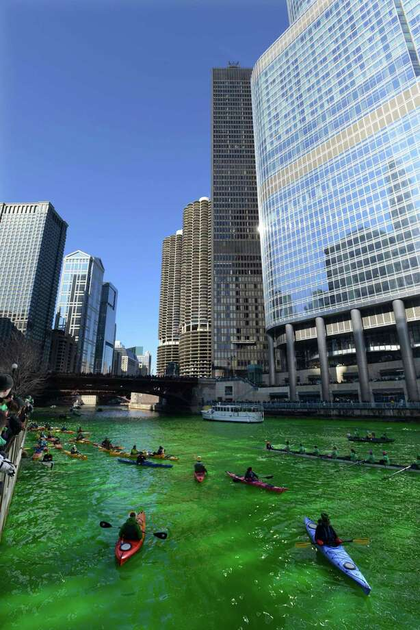 Kayakers float on the Chicago River after being dyed green ahead of the St. Patrick's Day parade in Chicago, Saturday, March 15, 2014. Photo: PAUL BEATY, AP / FR36811 AP