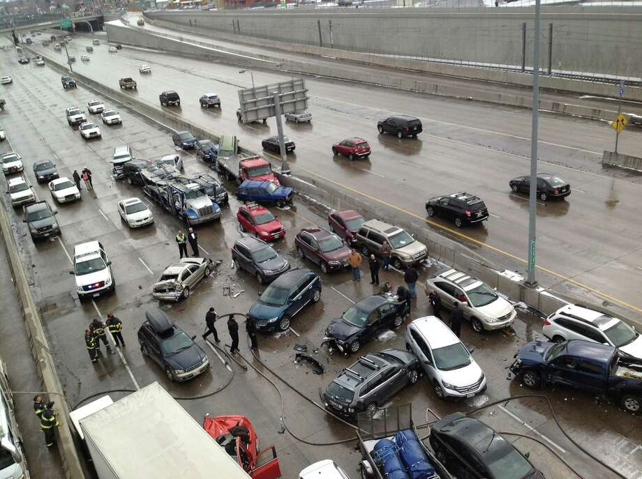 This photo provided by the Denver Police Dept. show a 104-car pileup alone the 2-mile stretch of Interstate 25 in Denver on March 1, 2014.  Authorities say no criminal charges will be filed after the massive pileup on Interstate 25 in Denver that left one woman dead and sent 30 others to the hospital. Denver police said Friday, March 14, 2014,  three cars initially lost control as a short but intense burst of snow slammed the area March 1. A tractor-trailer crashed into them, triggering the 104-car pileup along a roughly 2-mile stretch of the interstate. Investigators say traffic had been flowing normally, and none of the motorists could have anticipated the rapid change in weather.   Authorities say 61-year-old Rebecca Newkirk of Stillwater, Okla., was killed in the crash. Photo: AP / Denver Police Dept.