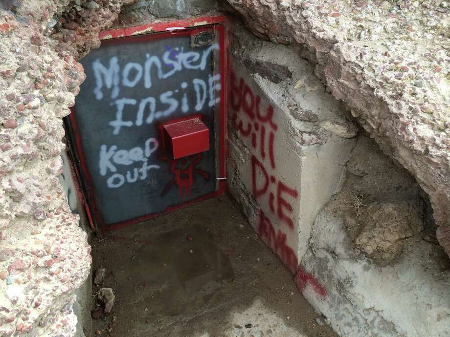This undated image provided by the Bureau of Land Management shows the vandalized entrance to Hidden Cave near Fallon, Nev. Federal officials are offering a $1,000 reward after someone spray-painted phrases at the archaeological site. Public tours to Hidden Cave are temporarily suspended while law enforcement investigates. Photo: Uncredited, AP / AP2014