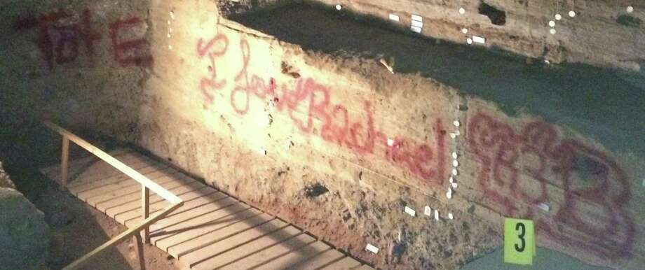 This undated image provided by the Bureau of Land Management shows the vandalized Hidden Cave near Fallon, Nev. Federal officials are offering a $1,000 reward after someone spray-painted phrases at the archaeological site. Public tours to Hidden Cave are temporarily suspended while law enforcement investigates. Photo: Uncredited, AP / BLM