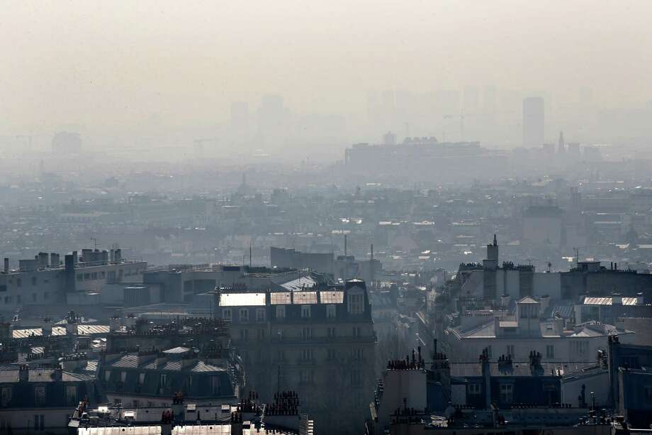 The center of Paris is seen through the smog, Thursday March 13, 2014, as pollution over the French capital is at high levels. In an official effort intended to curb air pollution, Paris Town Hall announced that residential parking will be free Thursday to encourage drivers to leave their cars at home and take public transportation. Photo: Christophe Ena, AP / AP
