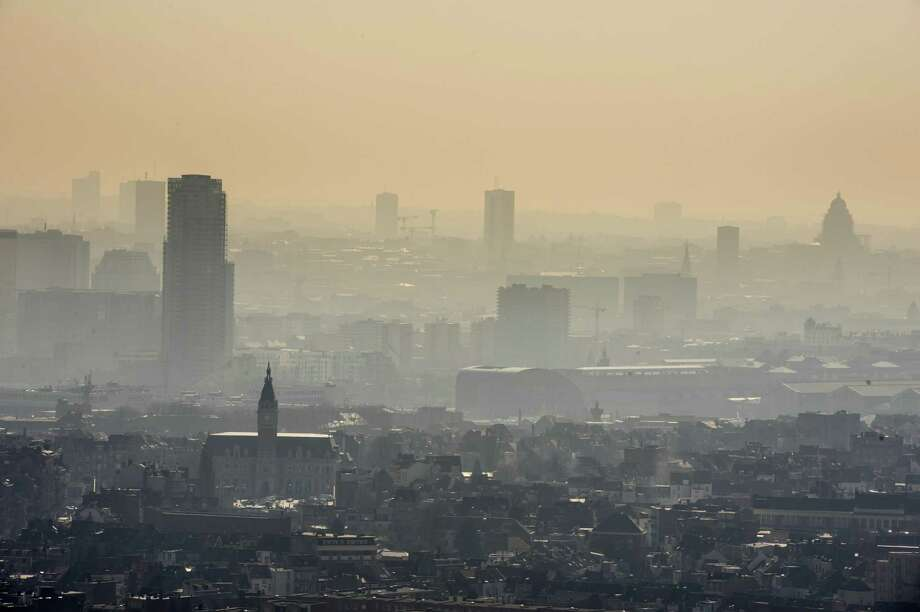 A layer of smog covers the city of Brussels on Friday March 14, 2014. The INRIX traffic scorecard rated Belgium as the most congested country in the world with the Belgian cities of Antwerp and Brussels the most congested. The INRIX Traffic Scorecard provides a comprehensive analysis of the state of traffic congestion across the world. With more than 300,000 cars entering Brussels everyday and an average of 85,4 hours of traffic jams per car per year, road traffic is one of the main sources of air pollution in Brussels. As a result of the Smog alert maximum speed on the motorway has been cut to 90km/h (55mph). Photo: Geert Vanden Wijngaert, AP / AP