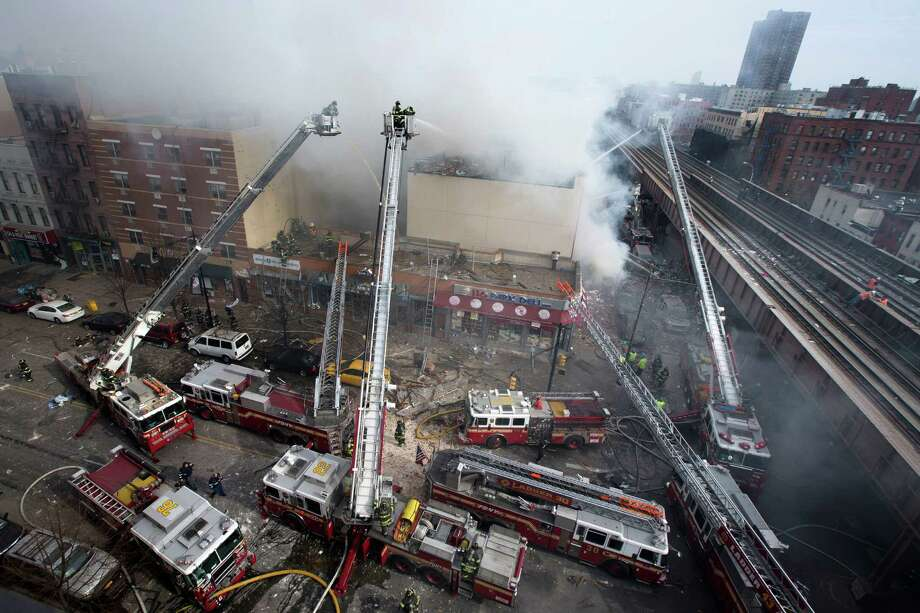 Firefighters battle a fire after a building collapses in the East Harlem neighborhood of New York, Wednesday, March 12, 2014 Photo: John Minchillo, AP / AP2014