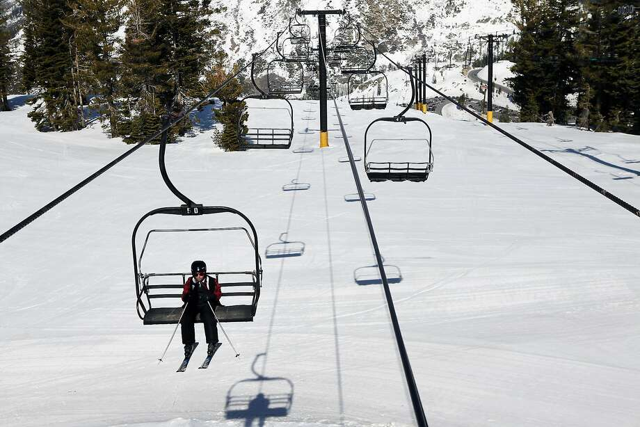 A boy has lots of chairlift seats to himself on Saturday at the Bear Valley resort, which is fighting to survive. Photo: Michael Short, The Chronicle