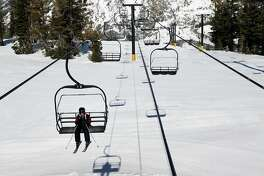 A boy rides chair lifts by himself at the Bear Valley Mountain Resort in Bear Valley, CA, Saturday, March 15, 2014.