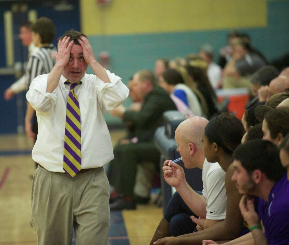 Westhill's head coach Mike King watches the clock at the end of the Connecticut Class LL girls state basketball tournament game between Westhill High School and South Windsor High School, played at Kennedy High School, Waterbury, Conn, on Friday, March 14, 2014. Photo: H John Voorhees III / The News-Times Freelance