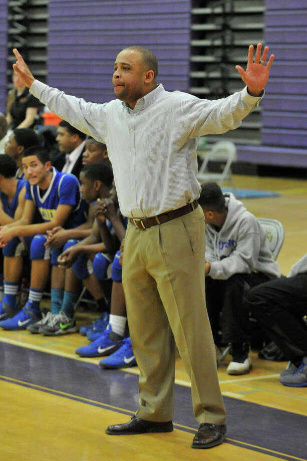 Harding head coach Charles Clemons talks to his team during their Class LL basketball game against Westhill at Westhill High School in Stamford, Conn., on Tuesday, March 11, 2014. Harding won, 66-61. Photo: Jason Rearick / Stamford Advocate