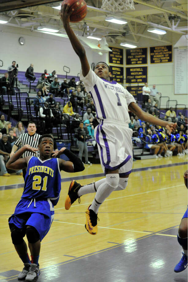 Westhill's Jeremiah Livingston lays the ball in uncontested during the Vikings' Class LL basketball game against Harding at Westhill High School in Stamford, Conn., on Tuesday, March 11, 2014. Harding won, 66-61. Photo: Jason Rearick / Stamford Advocate