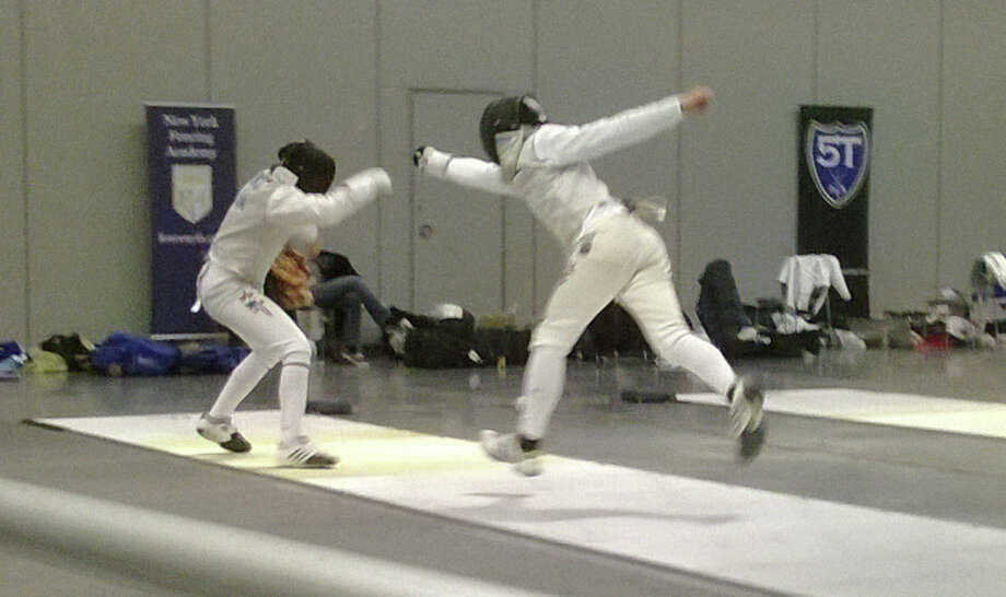 Harry McGuire, right, went undefeated in foil competition his four years on the Greenwich High School boys fencing team. The Cardinals recently won the Connecticut State Boys Fencing Team Championship for the first time in school history. Photo: Contributed Photo / Greenwich Time Contributed