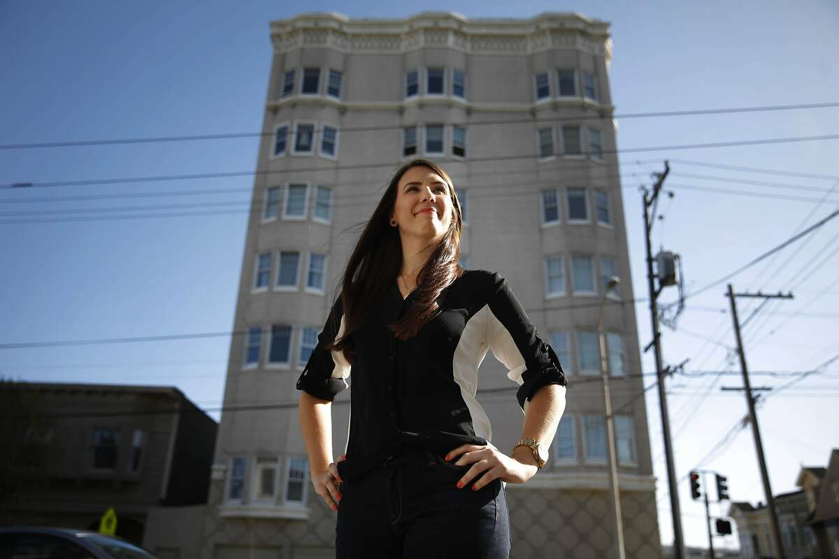 Melissa deKelaita, 29, of San Francisco poses for a portrait in front of the apartment building where she purchased her junior one bedroom condo in August of 2012 on Friday, March 14, 2014, in San Francisco, Calif. deKelaita purchased her junior one bedroom condo in August of 2012 using the San Francisco's Downpayment Assistance Loan Program.