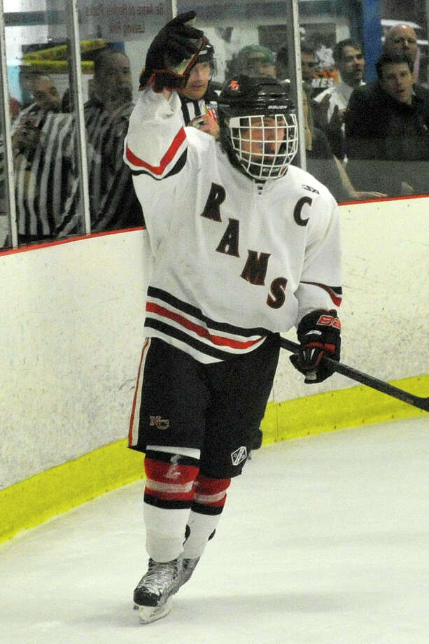 New Canaan's Harry Stanton raises his arm in celebration after scoring during the Rams' Division I hockey playoff game against Northwest Catholic at Darien Ice Rink in Darien, Conn., on Wednesday, March 12, 2014. New Canaan won, 6-2. Photo: Jason Rearick / Stamford Advocate