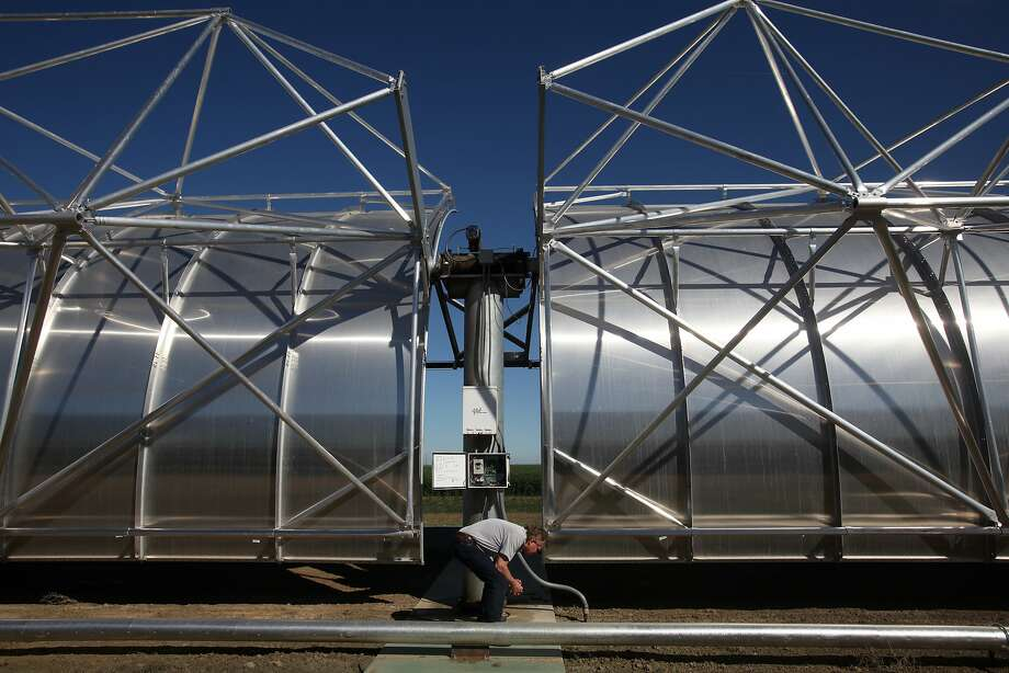 Consultant Bruce Marlow demonstrates a feature at the solar-powered WaterFX desalination plant in Fresno County. Photo: Leah Millis, The Chronicle