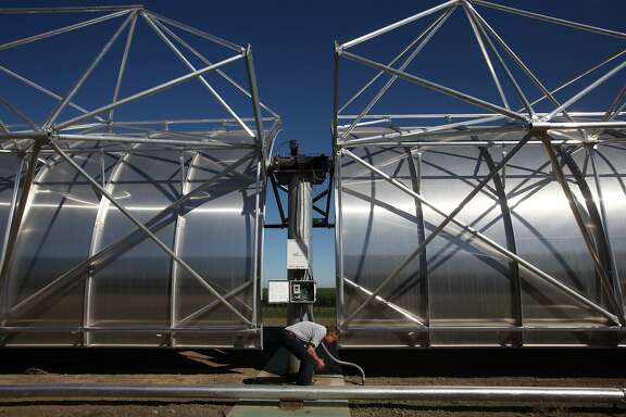 Bruce Marlow, consultant with AREVA Inc., demonstrates how the large solar troughs are used as part of the WaterFX desalination plant pilot project in Fresno County near the Panoche Water and Drainage District headquarters in Firebaugh, Calif. The demonstration plant uses solar troughs and Concentrated Solar Still technology to desalinate waste water provided by the Panoche Water and Drainage District. Mandell hopes to eventually build a plant that can process 2 million gallons of water a day, water that is sorely needed in the valley.