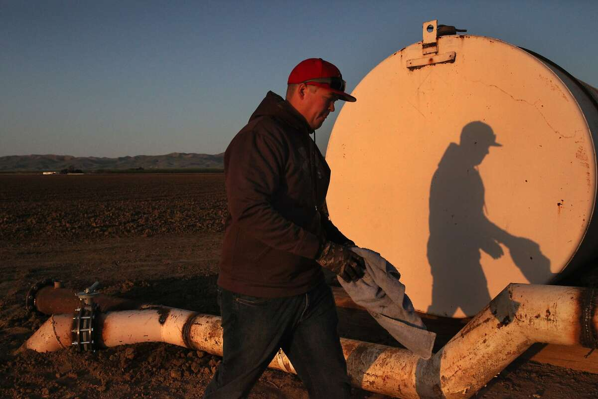 """Brian Hicks, 29, checks the water level at one of a few existing wells on his family's land March 15, 2014 at the Hammonds Ranch, Inc. in Firebaugh, Calif. The family have not had to use the wells in years. Now that they will be using them, instead of checking the levels once a month, Hicks will be checking them once every other week. The Hammonds Ranch is allowing over 4,000 acres of approximately 5,000 acres of farm land to fallow this year because of the drought. This year they will be keeping their grapes and some pistachios alive using well water they haven't had to tap in years and some supplemental water. Hicks, who lives on the ranch with his wife and young daughter, is a 4th generation Hammonds rancher. He is currently back in school to get his certification in special studies of enology, so he can get into wine making. Hicks says he's wanted to be part of the family business since he was a child. Despite the uncertainty that the drought brings, he's still pursuing his dream, """"I believe in it, it's something that everybody needs,"""" he said. """"Food is a necessity of life."""""""