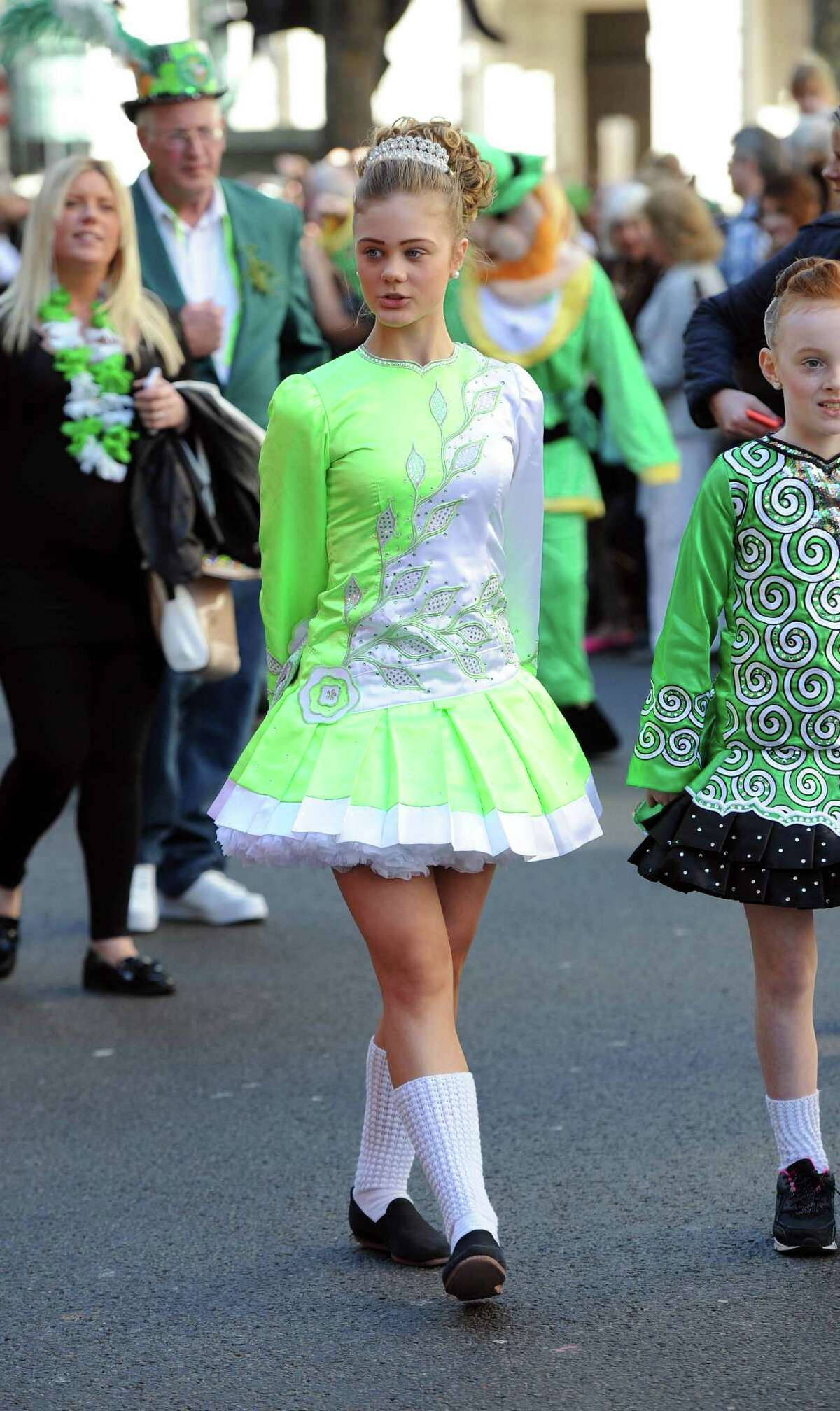 LONDON, ENGLAND - MARCH 16: A dancer dressed in an Irish themed costume participates in the annual St. Patrick's Day Festival as it passes from Piccadilly to Trafalgar Square through Haymarket on March 16, 2014 in London, England.