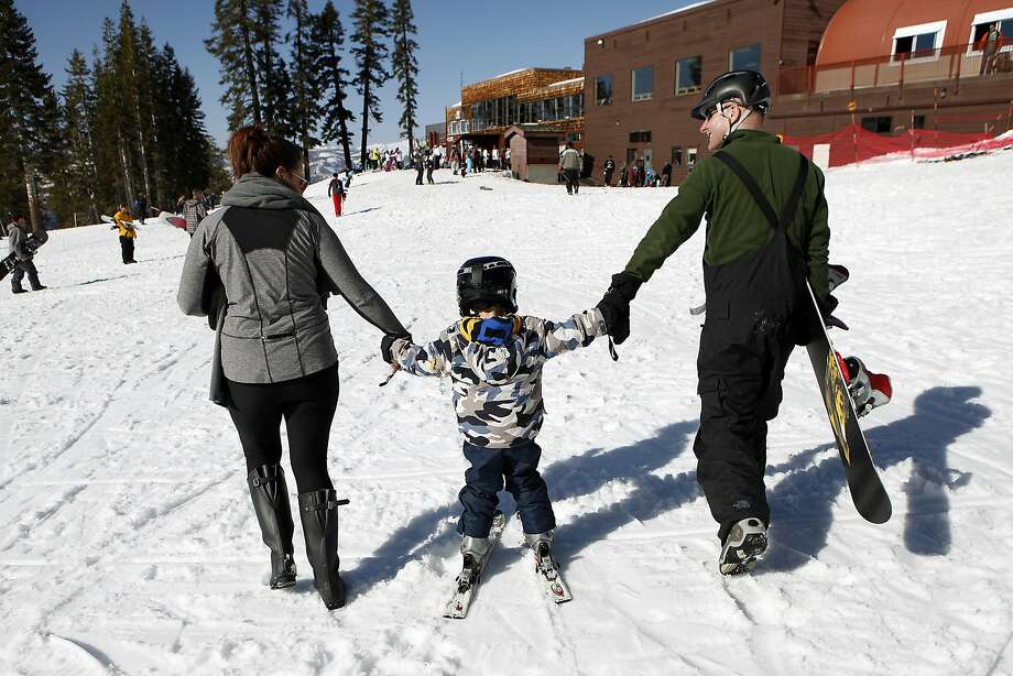 A family finishes a day of skiing at the troubled Bear Valley resort. Photo: Michael Short, The Chronicle