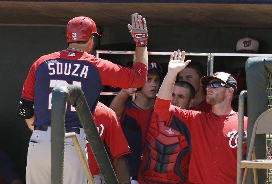 The Nationals' Steven Souza, left, is congratulated in the dugout after his second home run of the game during the fourth inning. Photo: Carlos Osorio, Associated Press