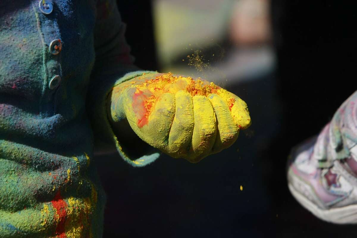 Aarya Shetty, 5, holds a handful of color during a holi celebration at the Vedic Dharma Samaj Fremont Hindu Temple on March 16, 2014 in Fremont, Calif. The Hindu celebration which features people throwing brightly colored powders at one another has become increasingly popular among different groups.