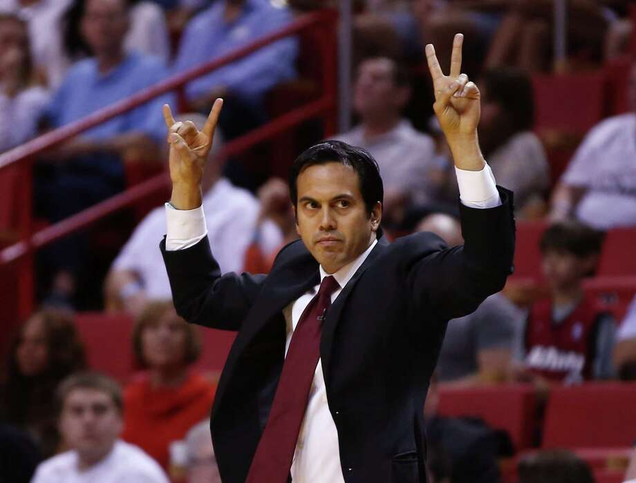 Miami Heat's coach Erik Spoelstra yells instructions to his team as they play the Houston Rockets during the first half of an NBA  basketball game in Miami, Sunday, March 16, 2014. (AP Photo/J Pat Carter) Photo: J Pat Carter, Associated Press / AP
