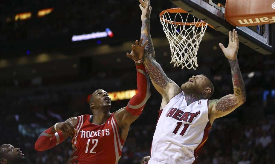 Chris Andersen goes around Dwight Howard for a shot. Photo: J Pat Carter, Associated Press