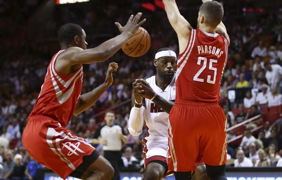 As Rockets players Terrence Jones and Chandler Parsons apply pressure, they force LeBron James to lose control of the ball. Photo: J Pat Carter, Associated Press