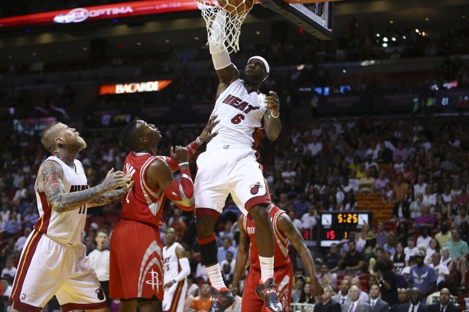 LeBron James goes around Chris Andersen and Dwight Howard for a two point shot. Photo: J Pat Carter, Associated Press