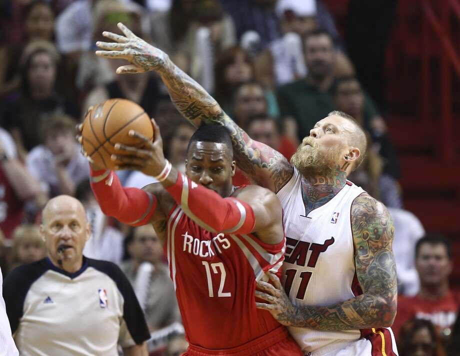 Chris Andersen reaches over Dwight Howard as he tries to steal the ball. Photo: J Pat Carter, Associated Press