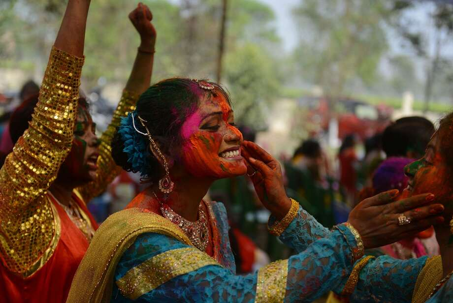 Indian revellers cover each other with coloured powder during celebrations for the Holi festival in Siliguri on March 16, 2014. Holi, the Festival of Colours, is a popular Hindu spring festival observed in India and Nepal at the end of winter season on the last full moon day of the lunar month. AFP PHOTO / Diptendu DUTTADIPTENDU DUTTA/AFP/Getty Images Photo: Diptendu Dutta, AFP/Getty Images