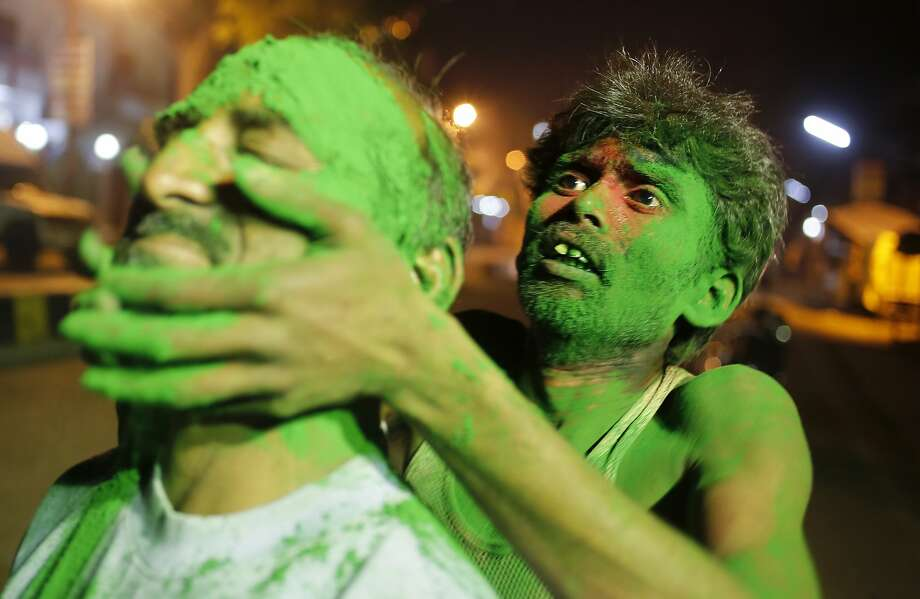 A man gets his face smeared with colored powder celebrate Holi, the Hindu festival of colors, in Allahabad, India, Sunday, March 16, 2014. The festival heralds the arrival of spring. (AP Photo/ Rajesh Kumar Singh) Photo: Rajesh Kumar Singh, Associated Press