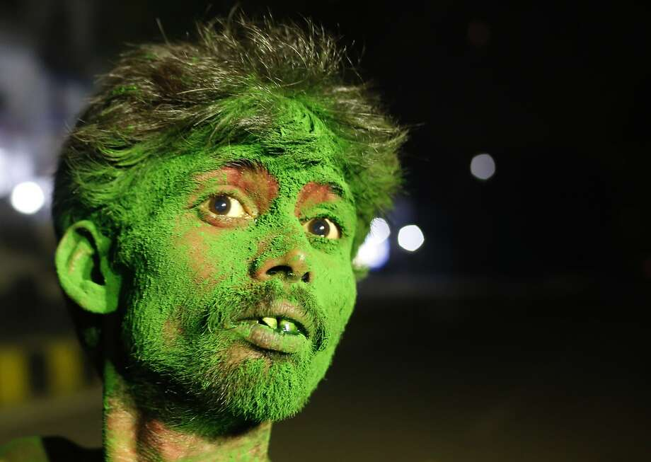 An Indian man has his face smeared with colors to celebrate Holi, the Hindu festival of colors, in Allahabad, India, Sunday, March 16, 2014. The festival heralds the arrival of spring. (AP Photo/ Rajesh Kumar Singh) Photo: Rajesh Kumar Singh, Associated Press