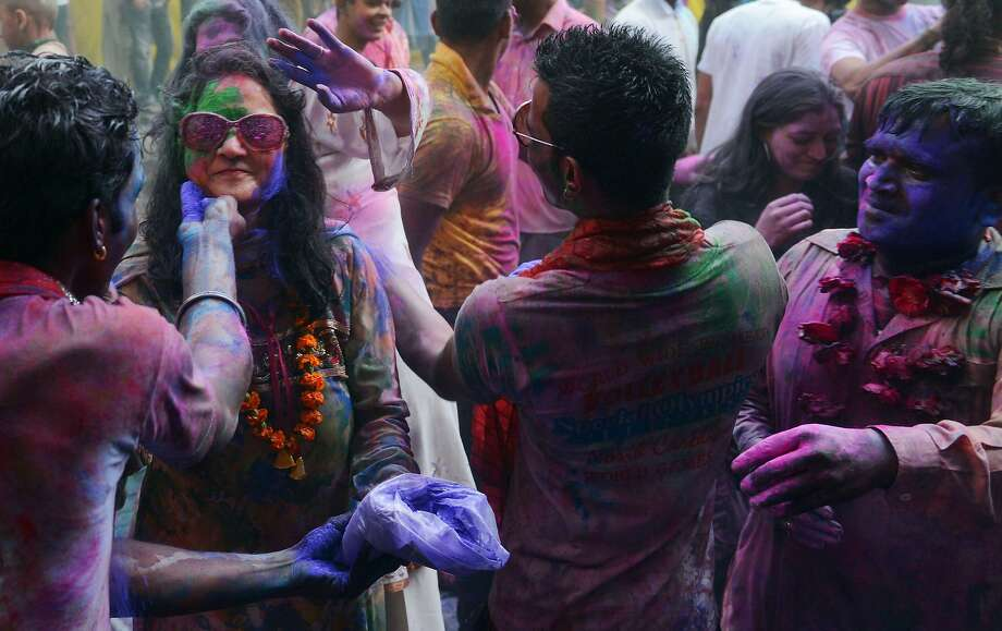 Pakistani Hindus paint each other's faces with coloured powder as they take part in celebrations for the Holi festival in Lahore on March 16, 2014. Holi, the popular Hindu spring festival of colours, is observed in Pakistan at the end of the winter season on the last full moon of the lunar month. AFP PHOTO/Arif ALIArif Ali/AFP/Getty Images Photo: Arif Ali, AFP/Getty Images