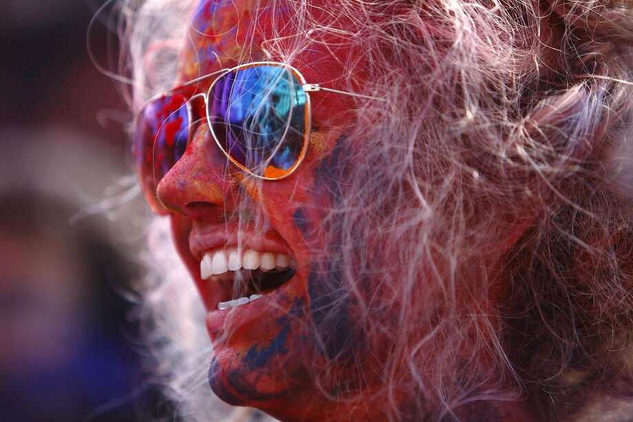 A tourist celebrates Holi, the Festival of Colours, in Kathmandu March 16, 2014. Holi marks the beginning of spring and is celebrated with great enthusiasm all over Nepal. REUTERS/Navesh Chitrakar (NEPAL - Tags: RELIGION SOCIETY TRAVEL) Photo: Navesh Chitrakar, Reuters