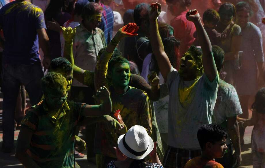 A group of teenagers dance during a Holi celebration at the Vedic Dharma Samaj Fremont Hindu Temple on March 16, 2014 in Fremont, Calif. The Hindu celebration which features people throwing brightly colored powders at one another has become increasingly popular among different groups. Photo: Codi Mills, The Chronicle