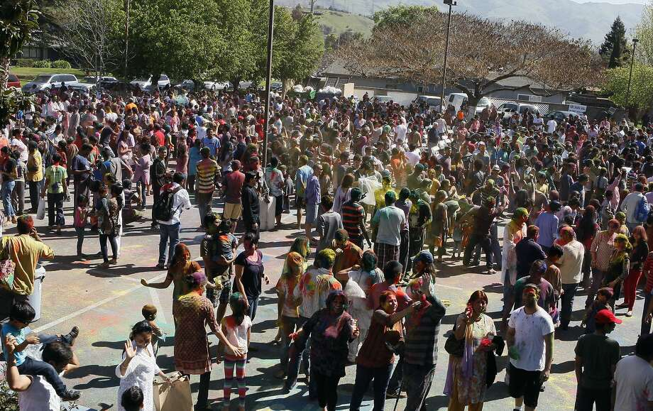 Hundreds of people gather together during a Holi celebration at the Vedic Dharma Samaj Fremont Hindu Temple on March 16, 2014 in Fremont, Calif. The Hindu celebration which features people throwing brightly colored powders at one another has become increasingly popular among different groups. Photo: Codi Mills, The Chronicle