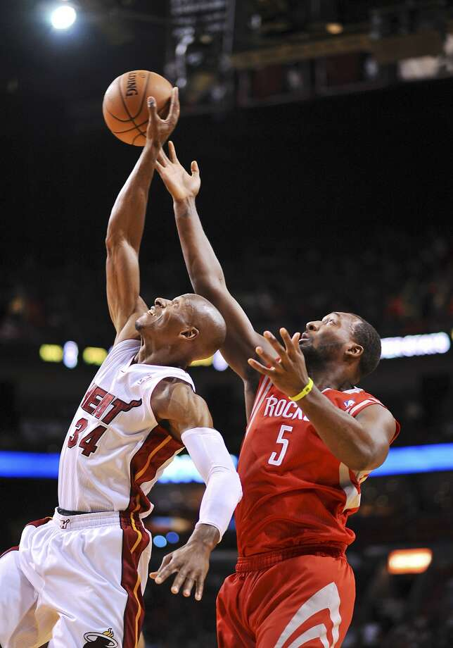 The Heat's Ray Allen battles with the Rockets' Jordan Hamilton for a rebound. Allen led Miami with 25 points. Photo: Steve Mitchell, Reuters
