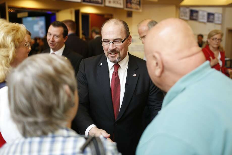 Republican gubernatorial candidate Tim Donnelly (center), an assemblyman who is a Tea Party favorite, greets a well-wisher at the state GOP convention in Burlingame. Photo: Stephen Lam, Reuters