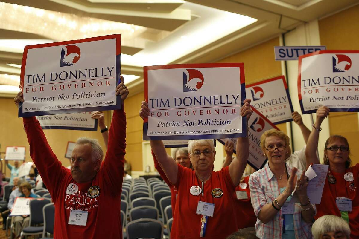 Supporters of California Republican gubernatorial primary candidate Tim Donnelly hold signs as Donnelly delivers a speech at the California Republican Party Spring Convention in Burlingame, California March 16, 2014 REUTERS/Stephen Lam (UNITED STATES - Tags: POLITICS)