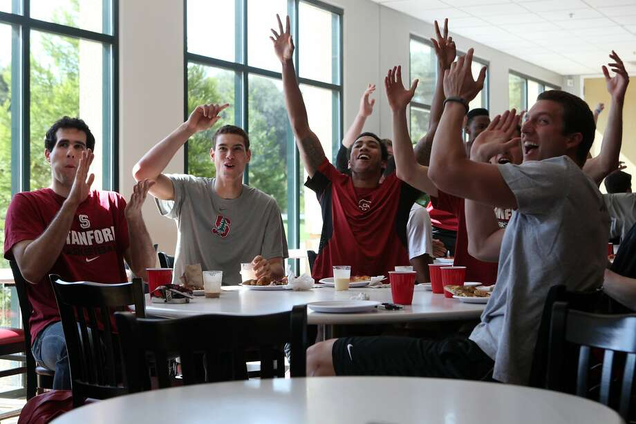 Stanford players Stefan Nastic (left), Dwight Powell, Josh Huestis and Anthony Brown celebrate after seeing that the Cardinal had earned an NCAA Tournament berth - the school's first since 2008 and first under coach Johnny Dawkins. Photo: Deborah Svoboda, The Chronicle
