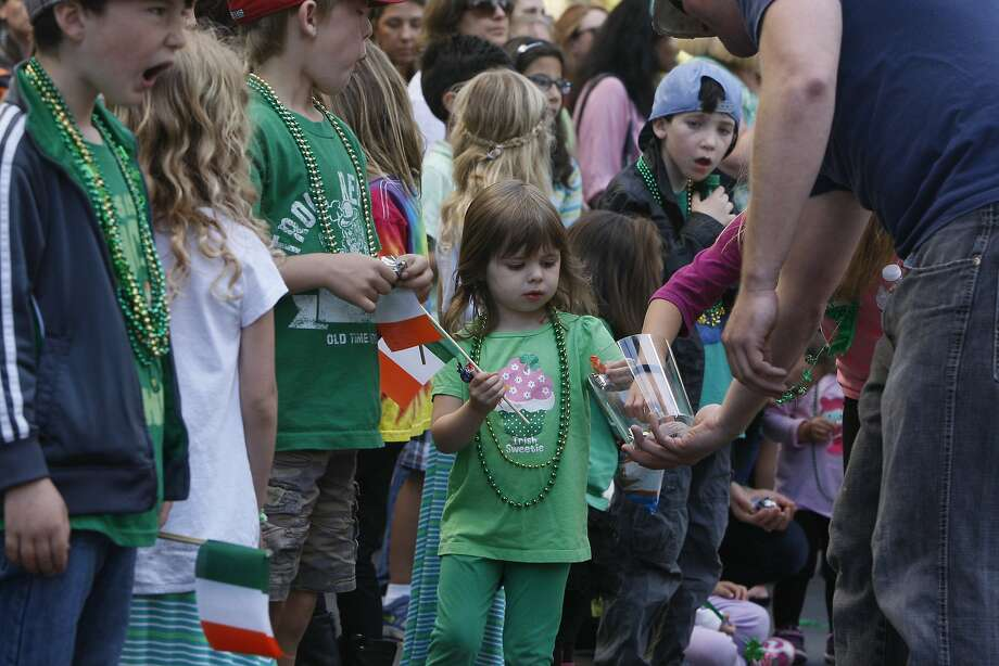 Aislinn Forte, 3, gets candy during the St. Patrick's Day Parade on March 15, 2014 in San Francisco, Calif. The 163rd annual parade ran from down a packed 2nd Street and Market to the Civic Center with dozens of floats. Photo: Codi Mills, The Chronicle