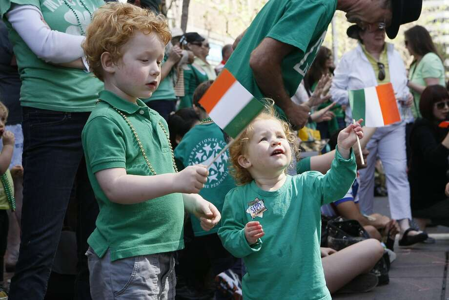 Fiona Hale, 2, (center) and Colin Hale, 3, wave flags during the St. Patrick's Day Parade on March 15, 2014 in San Francisco, Calif. The 163rd annual parade ran from down a packed 2nd Street and Market to the Civic Center with dozens of floats. Photo: Codi Mills, The Chronicle