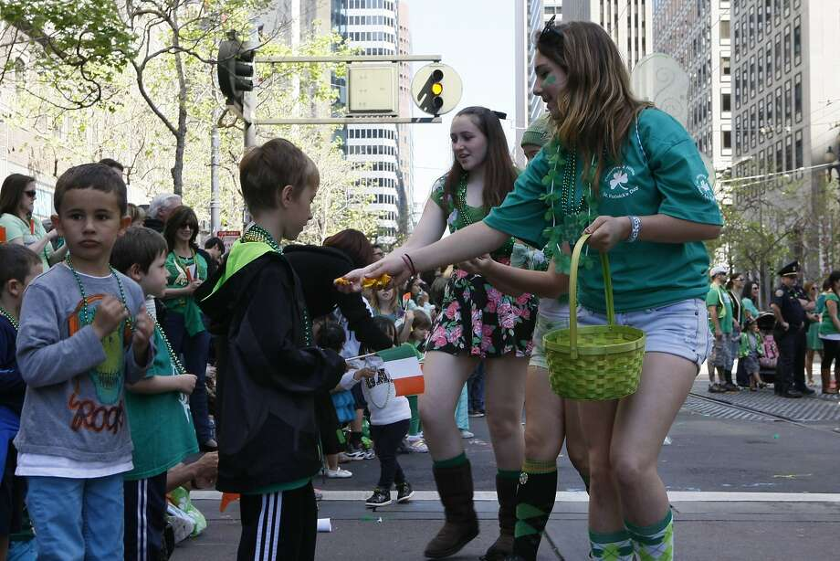 Parade participants from the Local 38 Plumber and Pipefitters Association hand out candy during the St. Patrick's Day Parade on March 15, 2014 in San Francisco, Calif. The 163rd annual parade ran from down a packed 2nd Street and Market to the Civic Center with dozens of floats. Photo: Codi Mills, The Chronicle