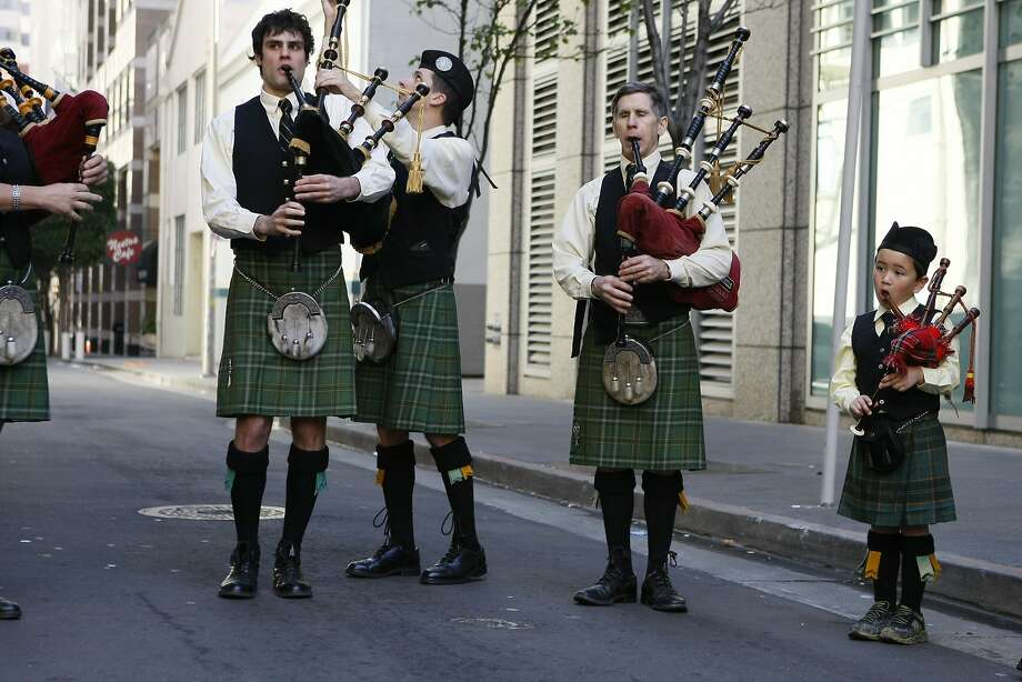 Stephen Bailey, (left), Mike Bowler (center), and Lars Land, 5, (right) play bagpipes before the St. Patrick's Day Parade on March 15, 2014 in San Francisco, Calif. The 163rd annual parade ran from down a packed 2nd Street and Market to the Civic Center with dozens of floats. Photo: Codi Mills, The Chronicle