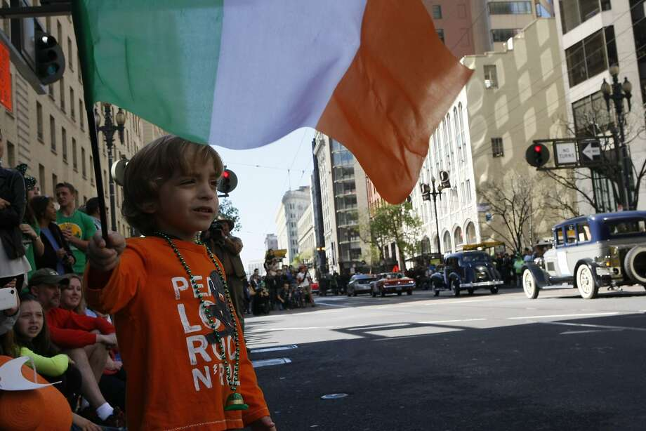 Caleb Elmore, 4, waves a flag during the St. Patrick's Day Parade on March 15, 2014 in San Francisco, Calif. The 163rd annual parade ran from down a packed 2nd Street and Market to the Civic Center with dozens of floats. Photo: Codi Mills, The Chronicle