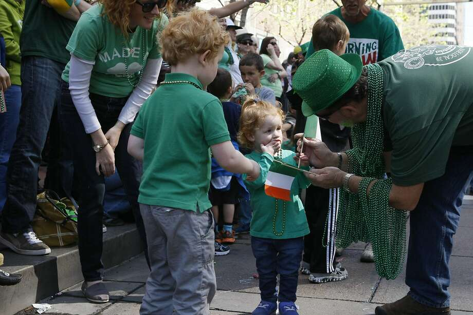 Fiona Hale, 2, (center) and Colin Hale, 3, get flags during the St. Patrick's Day Parade on March 15, 2014 in San Francisco, Calif. The 163rd annual parade ran from down a packed 2nd Street and Market to the Civic Center with dozens of floats. Photo: Codi Mills, The Chronicle