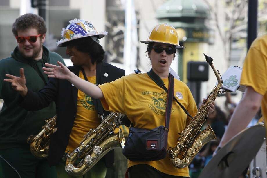A member of the Humbolt State University marching band waves during the St. Patrick's Day Parade on March 15, 2014 in San Francisco, Calif. The 163rd annual parade ran from down a packed 2nd Street and Market to the Civic Center with dozens of floats. Photo: Codi Mills, The Chronicle