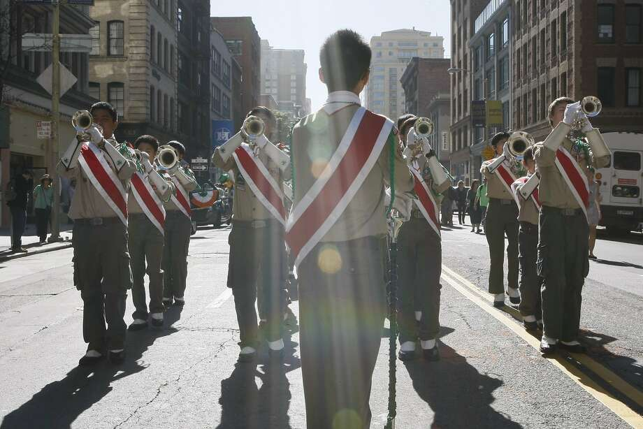 Larry Louie, 20, leads the Boy Scouts Troop 12 drum and bugle corps during the St. Patrick's Day Parade on March 15, 2014 in San Francisco, Calif. The 163rd annual parade ran from down a packed 2nd Street and Market to the Civic Center with dozens of floats. Photo: Codi Mills, The Chronicle
