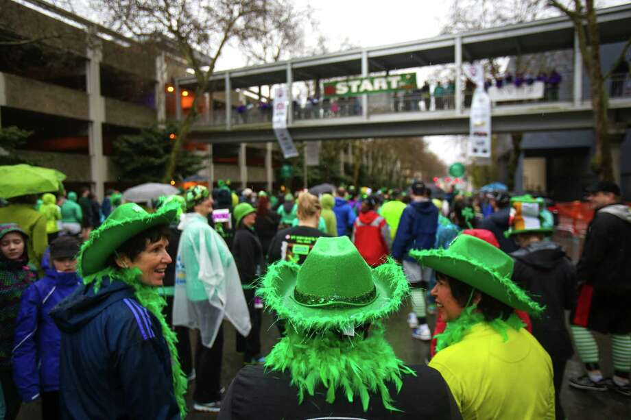 People gather at the start line during the annual St. Patrick's Day Dash. Thousands of runners participated in the run on Sunday, March 16, 2014. The event benefits the Detlef Schrempf Foundation. Photo: JOSHUA TRUJILLO, SEATTLEPI.COM / SEATTLEPI.COM