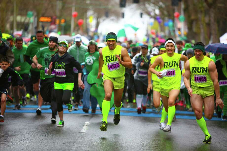 Runners take off from the start line during the annual St. Patrick's Day Dash. Thousands of runners participated in the run on Sunday, March 16, 2014. The event benefits the Detlef Schrempf Foundation. Photo: JOSHUA TRUJILLO, SEATTLEPI.COM / SEATTLEPI.COM